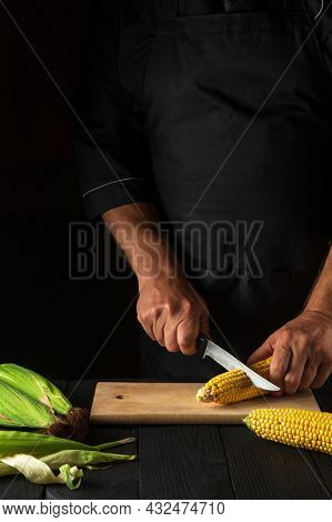 The Cook Cuts Fresh Corn With A Knife. Boiled Corn Is A Great Diet For Breakfast Or Lunch. Working E