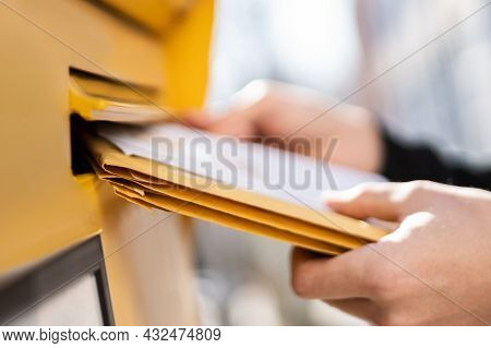 Envelope Mail Delivery In Mailbox. Postman Putting Letter