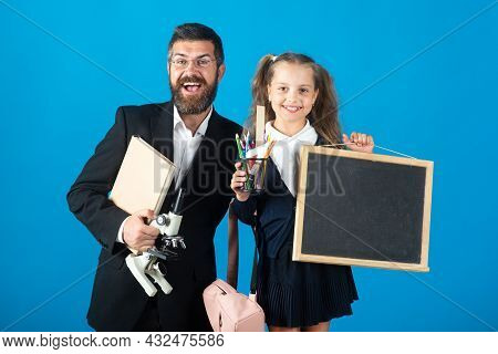 First Day At School. Father And Little Child School Girl In First Grade. Amazed Teacher With Excited