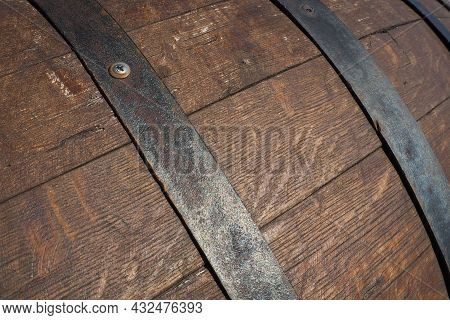 A Traditional Old Wooden Barrel With Curved Walls And Metal Hoops. Dishes For The Ripening Of Alcoho