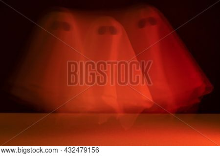 A Blurry Ghost Flies With A Bloody Tint. Halloween Holiday