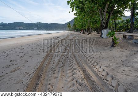 4x4 Tyre Tracks Crisscrossing Tire Tracks On The Sand Texture Background At Patong Beach Phuket Thai