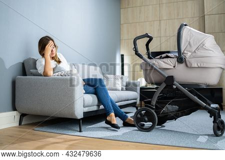 Depressed Unhappy Woman With Newborn. Frustrated Mum