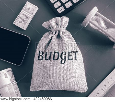 Money Bag With The Word Budget. Budgeting, Forecasting Income And Optimizing Expenses. Planning Expe