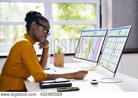 Unhappy Bored African American Woman At Office Computer