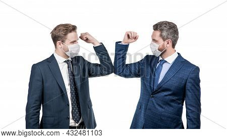 Businessmen In Mask Bumping Elbows Instead Of Shaking Hands To Avoid Contact, Business Greeting.
