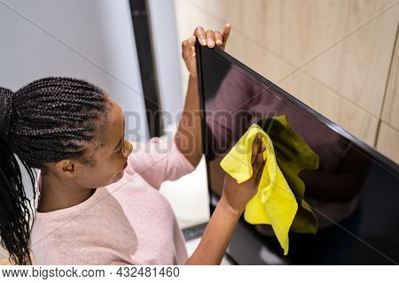 Cleaning Tv In Living Room Using Wiping Rag