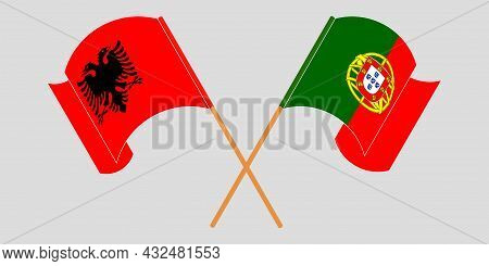 Crossed And Waving Flags Of Albania And Portugal