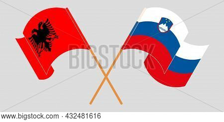 Crossed And Waving Flags Of Albania And Slovenia