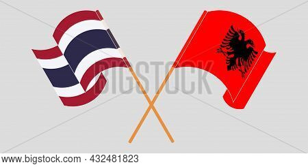 Crossed And Waving Flags Of Albania And Thailand