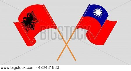 Crossed And Waving Flags Of Albania And Taiwan