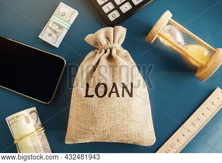 Money Bag With The Word Loan. The Concept Of Accumulation Of Money For The Payment Of Credit Debt. M