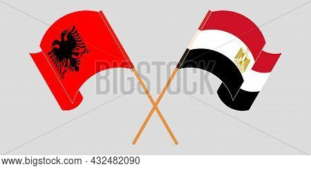 Crossed And Waving Flags Of Albania And Egypt