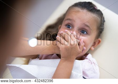 Scared Child Visiting Dentist In Dental Clinic