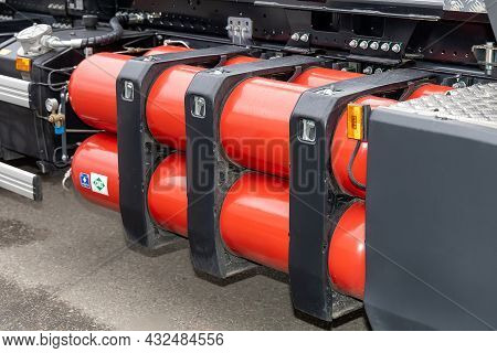 A Stack Of Compressed Natural Gas Cylinders On A Truck Frame. Truck With A Methane Engine. Cng As A