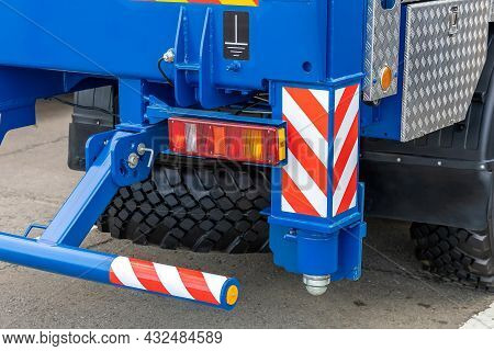 Fragment Of The Rear Part Of A New Wheeled Mobile Crane. Retractable Wheel Crane Outrigger, Spare Wh