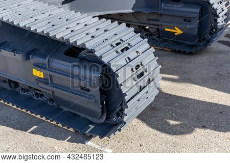 Fragment Of The Chassis Of The New Crawler Excavator. Crawler Track In Close-up. New Construction Eq