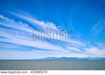 Wispy Clouds Over Georgia Strait. Light Clouds And Blue Sky Over The Strait Of Georgia.
