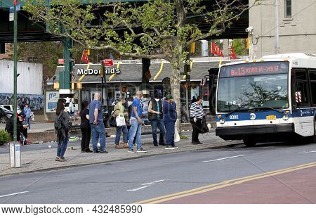 Bronx, New York, Usa - May 18, 2020: People Boarding Local Bus While Wearing Protective Masks Agains