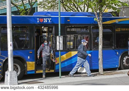 Bronx, New York, Usa - May 18, 2020: People Getting Off City Bus While Wearing Masks Against Covid.