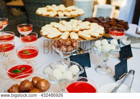 Glasses Of Smoothies Decorated With Mint Leaf, Eclair Cakes And Chocolates.