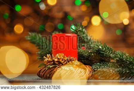 Christmas Home Room With Tree And Festive Bokeh Lighting, Blurred Holiday Background. Burning Candle