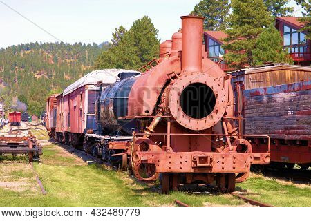 September 8, 2021 In Hill City, Sd:  Historical Steam Engine On Railroad Tracks On Display At The Hi