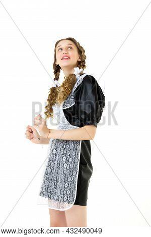 Portrait Of Happy Girl In Soviet School Uniform. Happy School Girl Wearing Dress With White Lace Apr