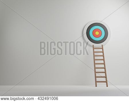 The Ladder Leaned Towards The Wall On Which The Target Was Hung With Copy Space , Business Achieveme