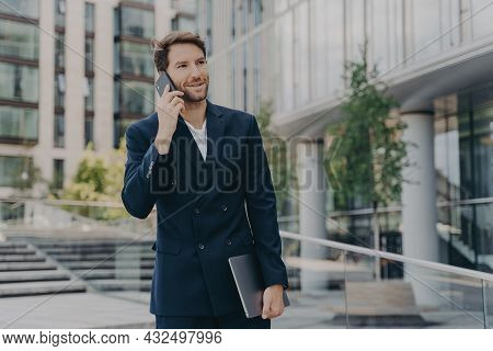 Handsome Unshaven Male Entrepreneur Communicates Distantly With Colleagues Or Partner Uses Modern Te