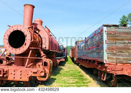 September 8, 2021 In Hill City, Sd:  Vintage Locomotive And Wooden Rail Cars On Display At The Hill