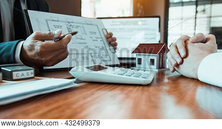 Agents Are Using Pens Pointing To Blueprint Home Design And Are Being Explained To Customers At The