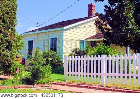 Renovated Historical Home With A White Picket Fence And Manicured Gardens Taken In A Residential Nei