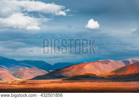 Yellow Autumn Mountains And The Blue Sky With Clouds At Sunset. Autumn Landscape Of Kurai Steppe In