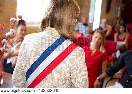 Rear Blonde Woman French Mayor Of The City During An Official Celebration In France City Hall