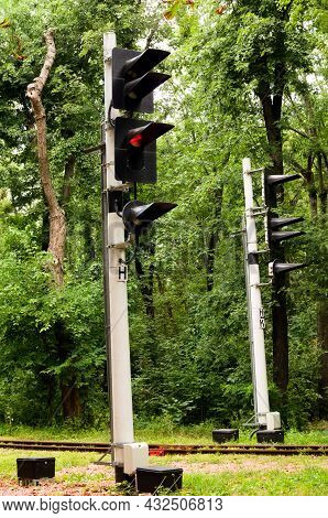 Traffic Lights At An Intersection. Railway Traffic Lights Show A Stop Signal. Narrow-guage Railway I