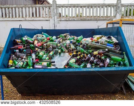 Moscow. Russia. July 23, 2021. A Large Garbage Bin Filled With Used Glass Bottles. The Concept Of Se