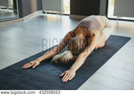 Yoga Class. Portrait Of Young Sportive Girl In Sportswear Doing Exercise On Sports Mat At Yoga Medit