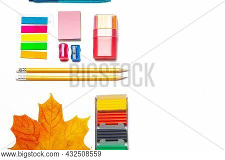 Office Supplies Layout On A White Background Copy Space . School Supplies. Colored Stationery. Isola