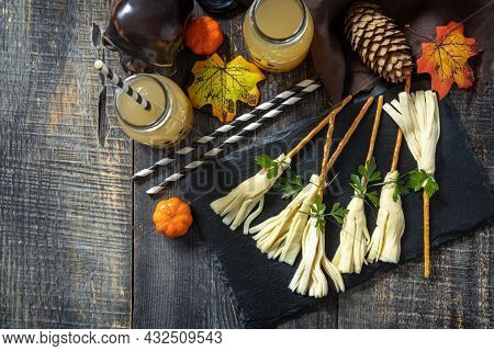 Halloween Funny Idea For Party Food. Halloween Creative Cheese Snack On A Wooden Table. Top View Fla