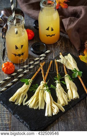 Halloween Funny Idea For Party Food. Halloween Creative Cheese Snack On A Wooden Table.