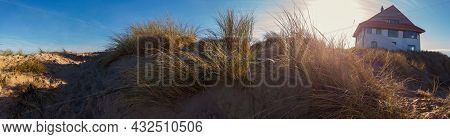 Panorama Of A Sand Dune With A Beachhouse At Koksijde  In Flanders In A Warm Autumnal Light