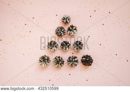 Christmas Tree From Pine Cones On Pink.