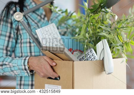Employee Trainee Holds Cardboard Box With Things Closeup