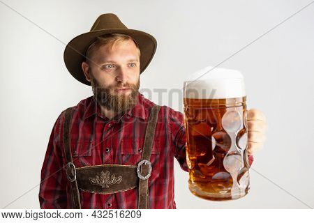 Half-length Portrait Of Bearded Man In Hat And Traditional Bavarian Costume Holding Huge Mug, Glass