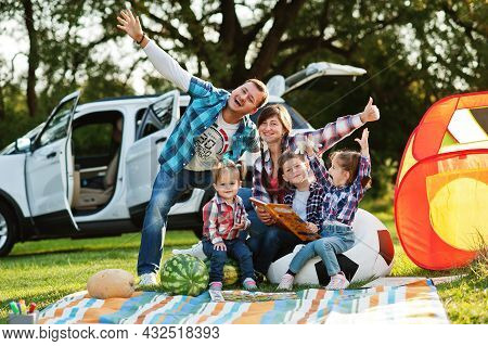 Family Spending Time Together. Three Kids. Outdoor Picnic Blanket.