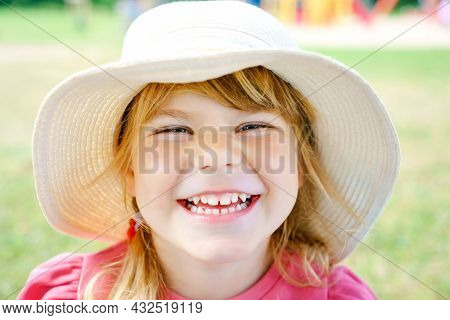 Portrait Of Preschool Girl With Straw Hat. Cute Happy Toddler Child Looking At The Camera And Smilin