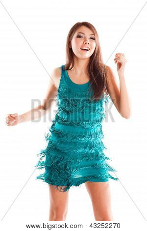 happy dancing woman in blue dress