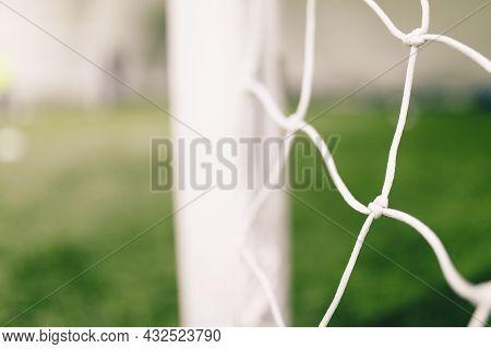Football Backgeound. Soccer Football Equipment. White Soccer Net On A Goal. Soccer Net Nodes. Blurre