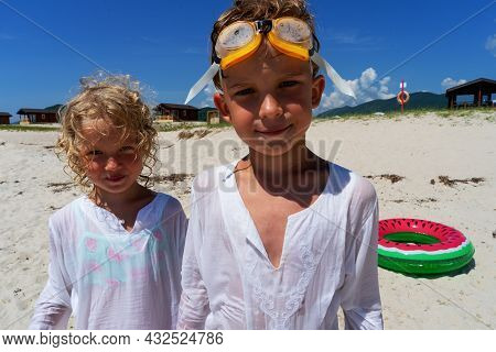 Closeup Portrait Of Funny Boy And Girl Kids Wearing Goggles On Head Posing At Beach Summer Travel Va